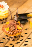 Graduation cupcakes with mortarboard confetti Stock Photos