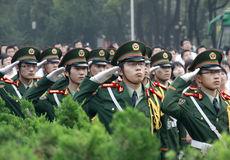 Graduation day. On graduation day the college students saluted to the national flag.All of them weared the PLA suit.Place:Tongji medical college in Wuhan city of Stock Image