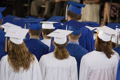 Graduation Day. Students in caps and gowns- viewed from behind Royalty Free Stock Images