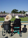 Graduation day. Grandmothers watching graduation ceremony Royalty Free Stock Images