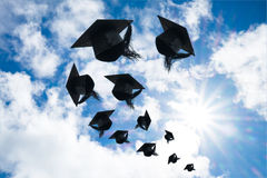 Graduation day, Images of graduation Caps or hat throwing in the. Air with sunshine day on blue sky background, Happiness feeling, Commencement day Royalty Free Stock Photography