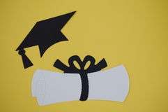 Graduation day paper cut outs. Of cap and diploma royalty free stock images
