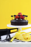 Graduation Day Party with Chocolate Cake. Happy Graduation Day yellow, black and white theme party with chocolate cake and strawberries Royalty Free Stock Image