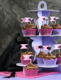 Graduation day pink and purple party chocolate cupcakes on stand Stock Image