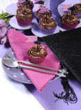 Graduation day pink and purple party table setting - vertical. Royalty Free Stock Photography