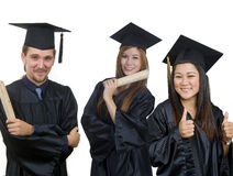 Graduation de trois étudiants Photos stock