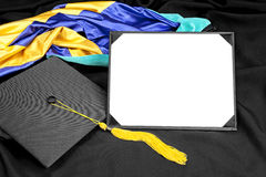 Graduation diploma. A graduation setting with cap,tassel, gown, hood and blank diploma for designers to place copy Royalty Free Stock Image