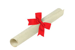 Graduation diploma with red ribbon isolated on white background Royalty Free Stock Photos