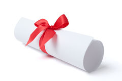 Diploma with red ribbon. Graduation diploma with red ribbon, isolated on white. Symbol of successful graduation Royalty Free Stock Photo