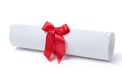 Graduation diploma scroll tied with red ribbon Royalty Free Stock Photo