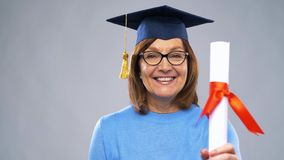 Happy senior graduate student woman with diploma stock video footage