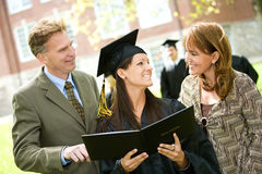 Graduation: Family Proud of Daughter. Extensive series of recent student graduates after graduation, outside with friends. Muti-ethnic group includes parents as royalty free stock photography