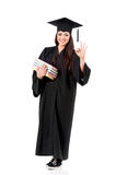 Graduation female student holding books Royalty Free Stock Photo