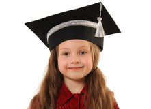 Graduation girl. Portrait of young clever girl in grad cap Stock Photos