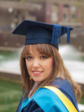 Graduation girl. Happy and smiling graduation girl outdoors Royalty Free Stock Photos