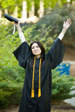 Graduation girl. A happy beautiful graduation girl holding the graduation cap Royalty Free Stock Photo