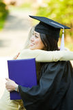 Graduation girl. A happy beautiful graduation girl being congratulated by her friend Royalty Free Stock Photos