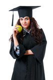 Graduation girl. Beautiful graduate girl student in mantle with green apple, isolated on white background Stock Image
