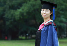 Graduation girl. In a blue graduation gown Royalty Free Stock Photos