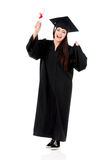 Graduation girl. Cheerful graduate girl holding diploma, isolated on white background Royalty Free Stock Photo