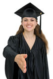 Graduation girl stretching hand for handshake. Isolated on white. Focus on hand Stock Images