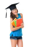 Graduation girl student. With books, isolated on white background Stock Photo