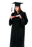 Graduation girl. Young graduation girl holding diploma, isolated on white background Royalty Free Stock Images