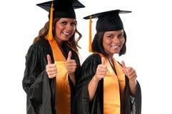 Graduation girls. Girls celebrating their graduation very happy royalty free stock photography
