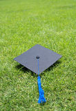 Graduation gown hat Stock Image