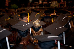 Graduation: A Graduate with a Unicorn on Her Cap. A Female student at a graduation ceremony a unicorn on her cap listening to the commencement speaker at the Royalty Free Stock Photography