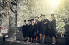 Graduation group. Happy group of students in their graduation smiling Stock Image