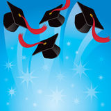 Graduation Hat Background. Graduation hats are thrown into a blue sky background Royalty Free Stock Photo