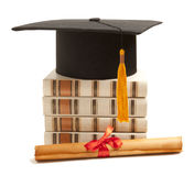 Graduation hat, book and diploma Stock Image