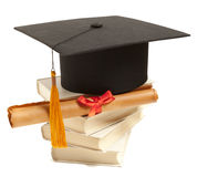 Graduation hat, book and diploma Royalty Free Stock Photo