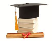 Graduation hat, book and diploma Royalty Free Stock Image