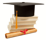 Graduation hat, book and diploma Stock Photography