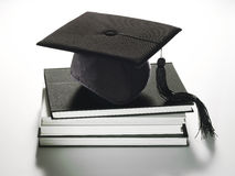 Graduation hat on books Stock Image