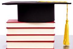 Graduation hat and books Stock Photo