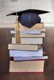 Graduation hat on books Stock Images