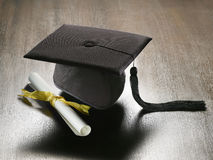 Graduation hat and diploma Royalty Free Stock Photo