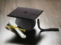 Graduation hat and diploma Royalty Free Stock Photo