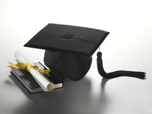 Graduation hat and diploma Royalty Free Stock Image