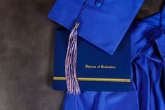 Graduation hat and diploma certificate front view royalty free stock photos