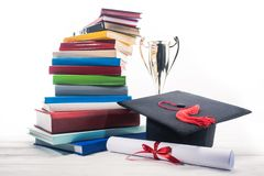 Graduation hat with diploma and trophy cup by stack stock photos