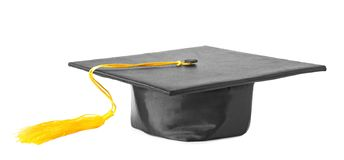 Graduation hat with gold tassel. Isolated on white stock photography