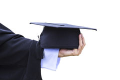 Graduation hat in hand Stock Photo