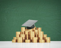 Graduation hat is laying on the coins pyramid. A concept of a high price for the university education. Royalty Free Stock Images