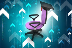 Graduation hat in office chair Royalty Free Stock Image