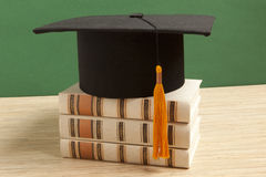 Graduation hat with old book Royalty Free Stock Photography
