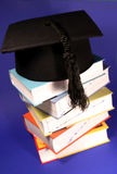 Graduation hat on a stack of books Royalty Free Stock Images
